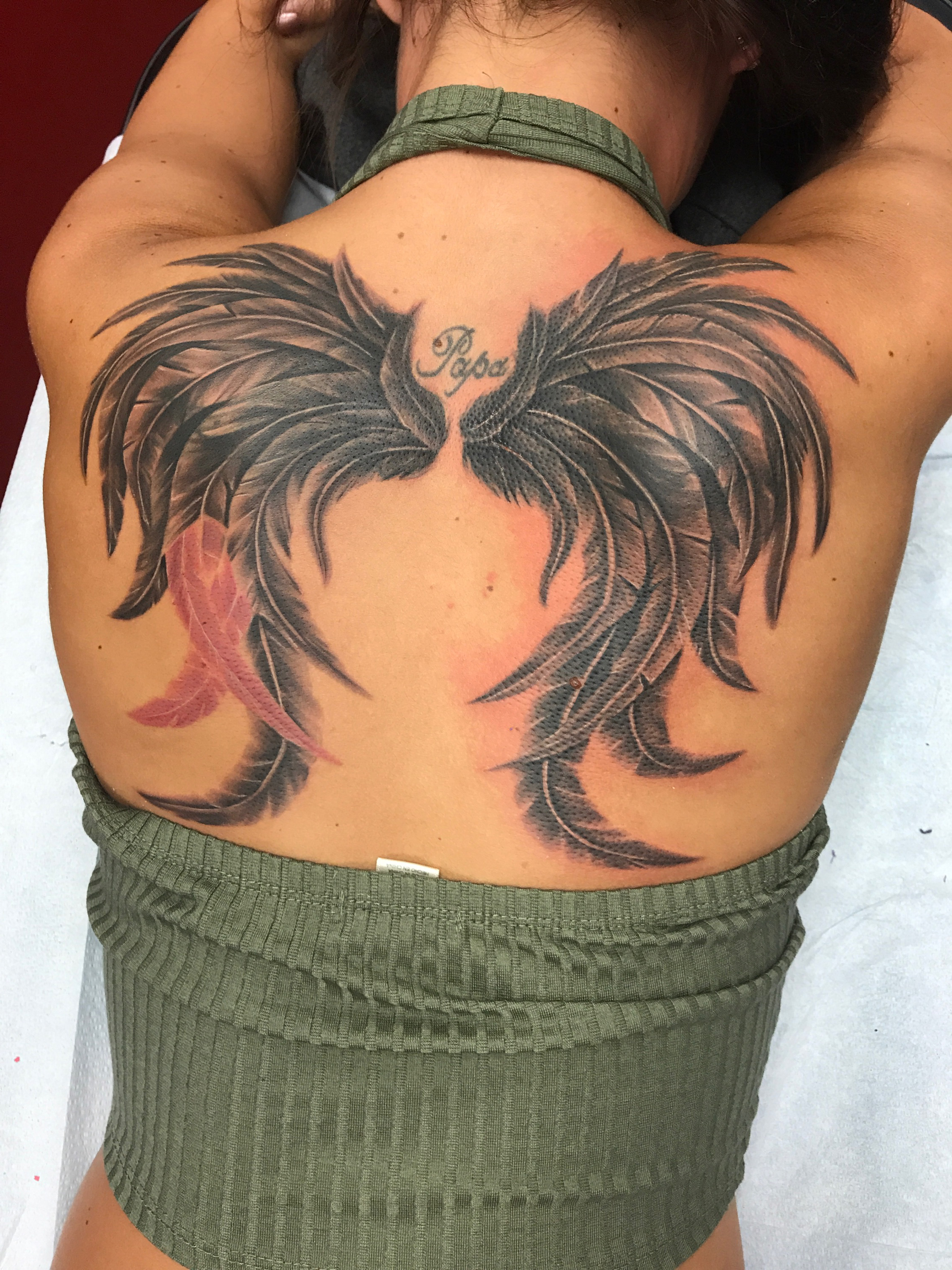 Q Tattoo in Huntington Beach - Quan - Back Piece Feather Wing