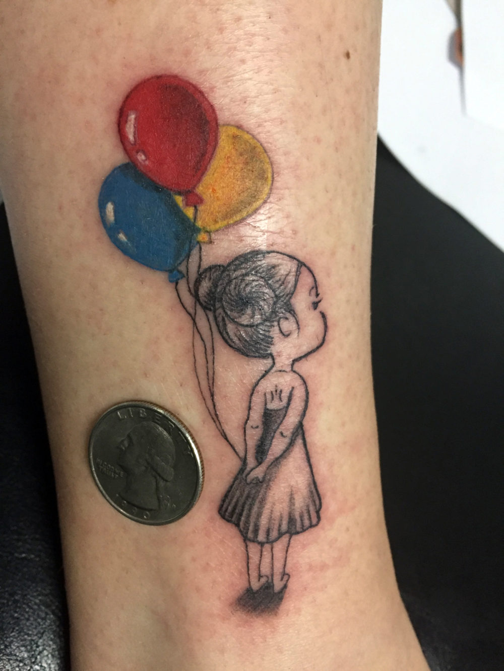 Q Tattoo in Huntington Beach - Karel Beck - the girl with her balloons - small tattoo