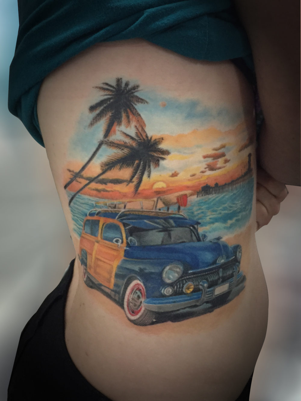 Q Tattoo in Huntington Beach - Karel Beck - olide, beach, woody