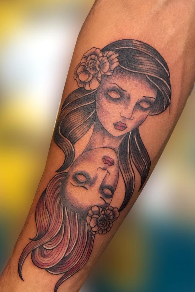 Q Tattoo in Huntington Beach - Sara Delara - dual heads