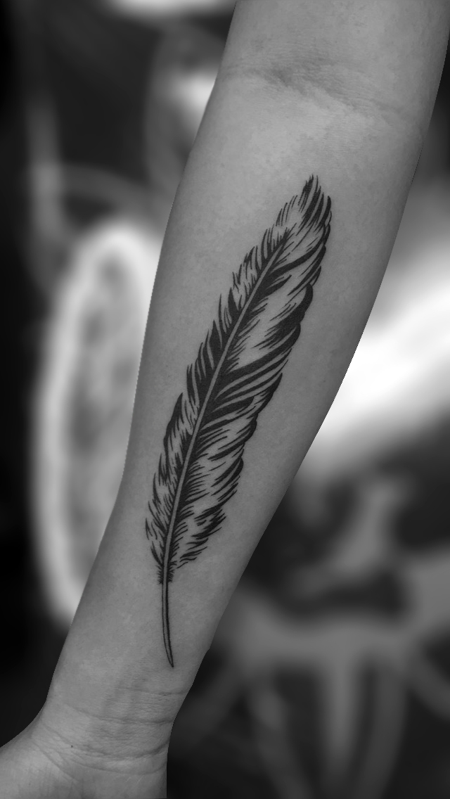 Q Tattoo in Huntington Beach - Sara Delara - feather arm tattoo