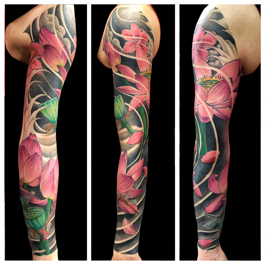 Q Tattoo in Huntington Beach - Quan - full arm flowers